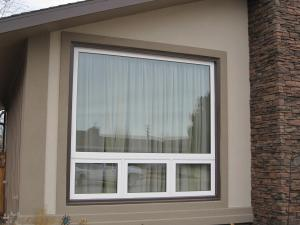 Casement Awnings With An Upper Picture Window