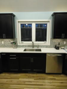 Double casement window over the sink for an easy to open window while reaching over the counter